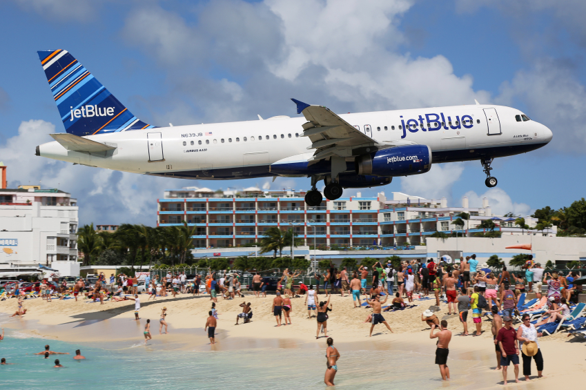 St. Martin, Netherlands Antilles - February 8, 2014: A jetBlue Airbus A320 with the registration N639JB approaching St. Martin Airport (SXM). St. Martin is rated one of the most dangerous airports in the world. JetBlue is an American airline, headquartered in New York City.