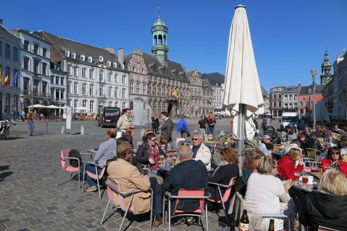 Mons, Belgium - October 1, 2015:  People enjoy a sunny afternoon at cafes on the Grand Place.  Mons, along with Pilsen in the Czech Republic, was a joint European Capital of Culture in 2015.