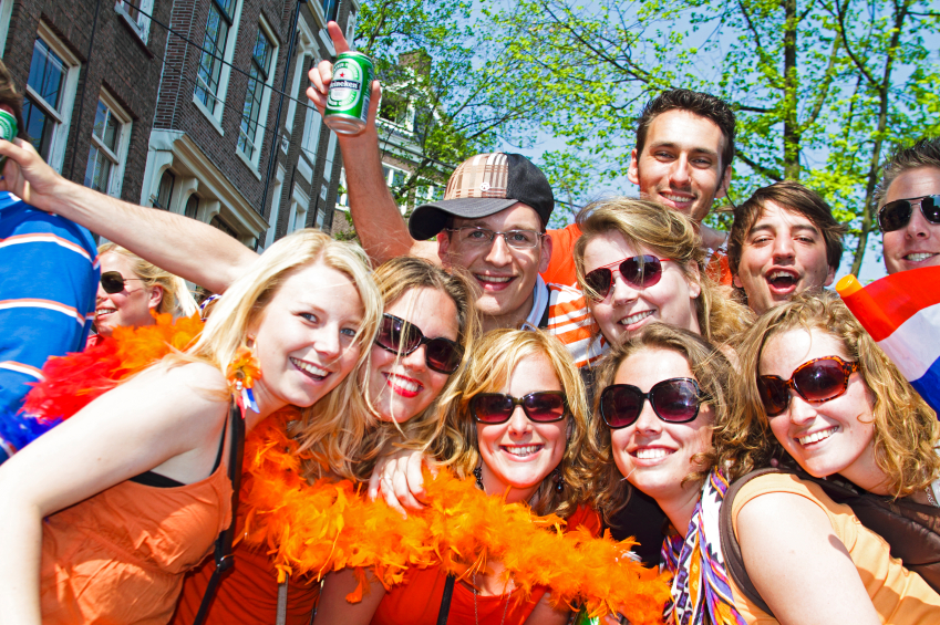 AMSTERDAM - APRIL 30: Group of friends in orange partying at the celebration of queensday on April 30, 2011 in Amsterdam, The Netherlands