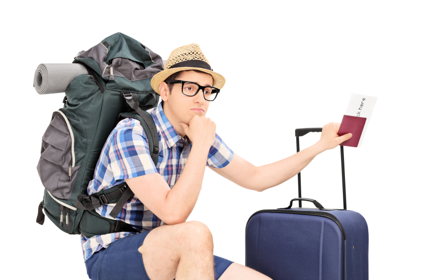 Worried male tourist holding passport and waiting