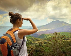 Woman traveler looking at Batur volcano. Indonesia.