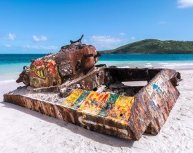 Rusted old tank covered in graffiti on famous Flamenco Beach on beautiful Isla Culebra, Puerto Rico
