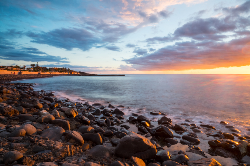 Palm-Mar beach in the south of Tenerife island, Canary. Rocks, ocean and sunset.