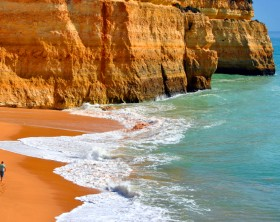 Benagil, Algarve, Portugal - October 27, 2015: Tourist walking on Benagil Beach on the Algarve coast
