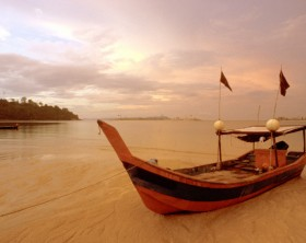 Fishing boat at Sunrise in Kuah beach, Langkawi lsland, Malaysia