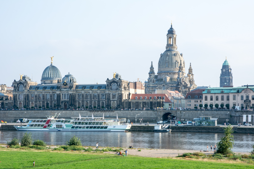 DRESDEN, GERMANY - SEPTEMBER 4: Tourists at the promenade of the river Elbe in Dresden, Germany on September 4, 2014. Dresden has almost 2 million visitors a year. Foto taken from Augustus bridge.
