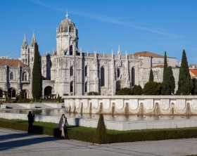 Lisbon, Portugal - January 4, 2013 : Jeronimos Monastery (Mosteiro dos Jeronimos with people along the street.