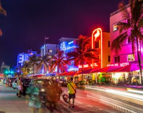 MIAMI, USA - AUG 19, 2014: peope visit Ocean drive buildings in Art deco style in Miami, USA. Art Deco district architecture is one of the main tourist attractions in Miami.