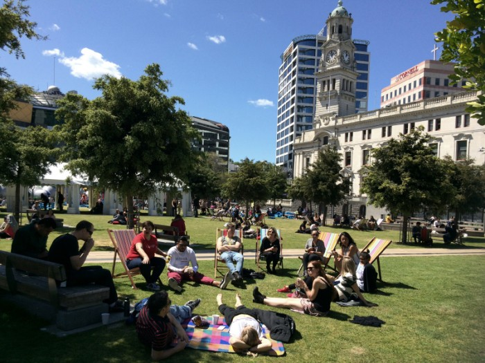 Auckland, New Zealand - October 9, 2015: Young Aucklanders in Aotea Square, Auckland New Zealand. Over 1. 4 million people live in Auckland, New Zealand - around a third of New Zealand's population.