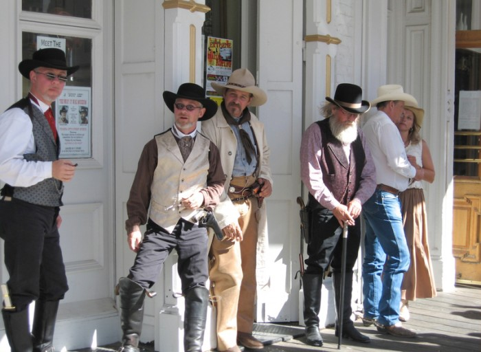 Virginia City, USA - July 17, 2006: A group of men dressed up as Cowboys and Sheriffs in front of the