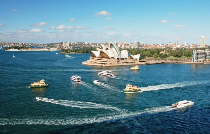 Sydney Opera House with ferrys in foregournd, taken from Harbour bridge