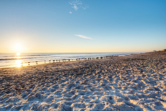 """Cocoa Beach, Florida at Sunrise with Clear Sky."""