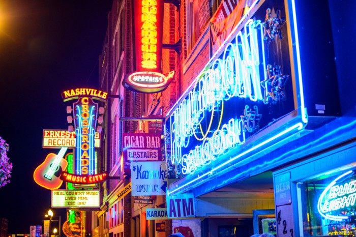 Nashville, Tennessee, USA - June 14, 2013: Honky-tonks on Lower Broadway. The district is famous for the numerous country music entertainment establishments.