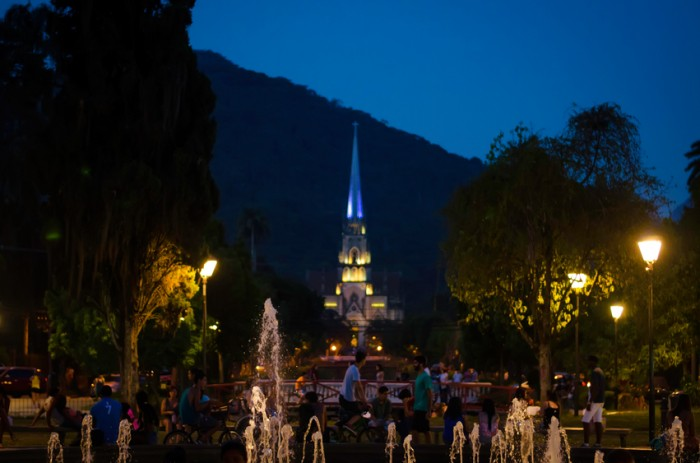 Petrópolis, Brazil- January 17, 2015: Metropolitan Cathedral  of Petropolis, Rio de Janeiro, Brazil. View from the Square of Freedom, where there is a fountain, and several people relaxing and having fun in an early dusk. The cathedral began to be built in 1884 in neo-Gothic style, and its patron is St. Peter of Alcantara.