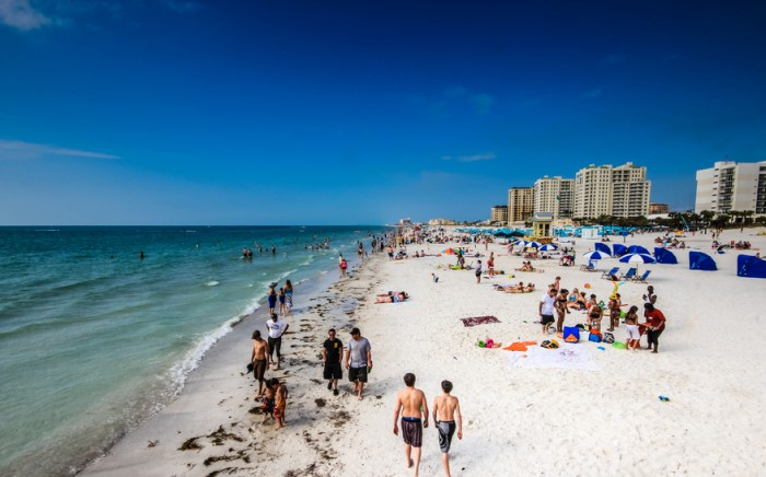 Clearwater, FL, USA - March 23, 2014: People relaxing and enjoying in Clearwater beachfront, Florida