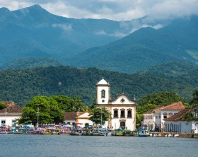 Tourist boats waiting for tourists near the Church Igreja de Santa Rita de Cassia in Paraty, state Rio de Janeiro, Brazil