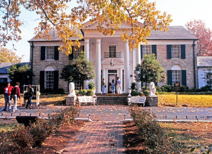 Memphis, United States - November 21, 1995: Front view of Graceland, the home of Elvis Presley with tourists enjoying the sights, during the Autumn, Memphis, Tennessee, United States of America.