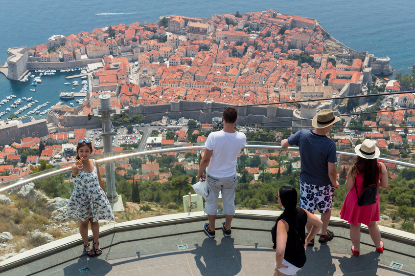 Dubrovnik, Сroatia - August 13, 2015: Tourist taking photo at mountain Srdj with town of Dubrovnik in background