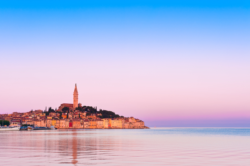 Stock photo of Rovinj old town at Adriatic coast of Croatia in sunrise light. Popular touristic destination at Istria region.
