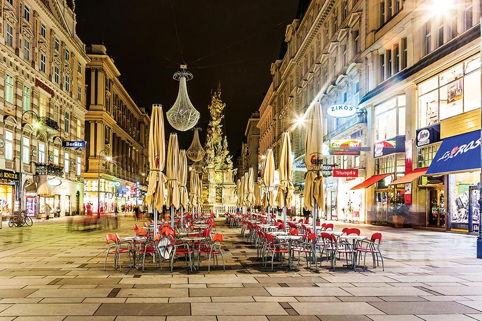 VIENNA, AUSTRIA - NOV 5, 2009: Vienna - famous Graben street at night with rain reflection on the cobbles in Vienna, Austria.