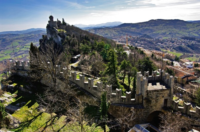 One of the three towers. The Republic of San Marino is a country in the Apennines. It is a landlocked enclave, completely surrounded by Italy. The Three Towers of San Marino are a group of towers located on the three peaks of Monte Titano in the capital, also called San Marino.