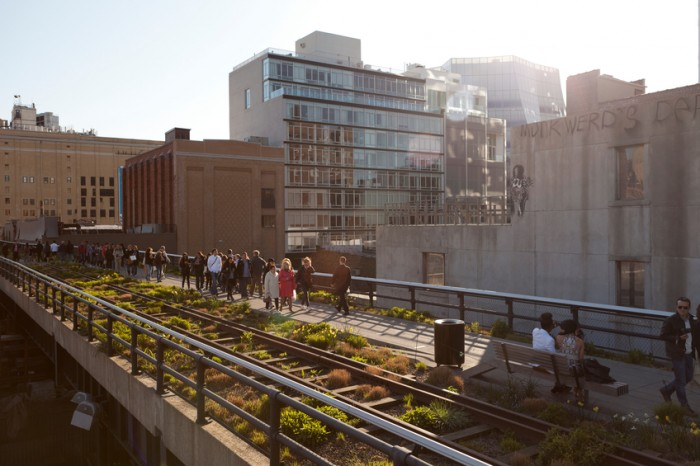 New York City, USA - April 7, 2012:  Tourists stroll along the elevated platform at the High Line park on the west side of Manhattan.