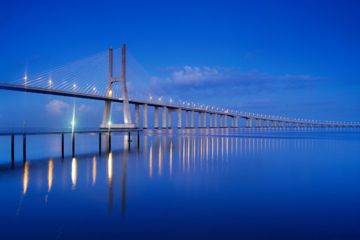 Vasco da Gama is the largest bridge in Europe with a length of 17.2 km (10 miles), 10 km of which are over the Tagus river. It was inaugurated on the 4th of April 1998. Located right next to the Nations Park (former site of the Expo 98) it got its name on the same year of the 5th centenary of the arrival of Vasco da Gama to India.