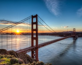 The Golden Gate Bridge at sunrise with San Francisco in the background.