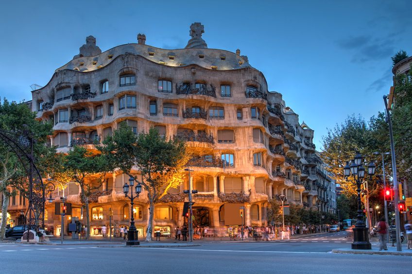 Barcelona, Spain - July 28, 2012: Twilight scene of Casa Mila (La Pedrera) in Eixample, Barcelona on July 28, 2012. Casa Mila an apartment building, is one of Antoni Gaudi's most famous works.