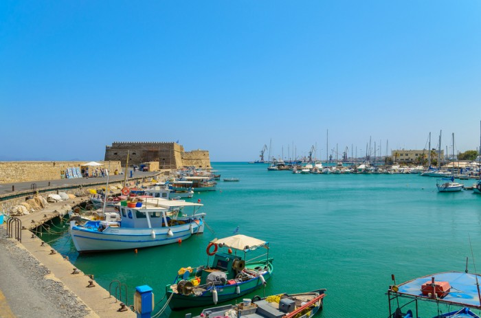 Heraklion, Greece - August 11, 2013: The traditional Greek fishing boats are located at Heraklion port. Heraklion is the main city of Crete island