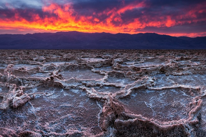 Breaking clouds and a sunset combine to create drama in the skies over Badwater in California's Death Valley National Park.  At 282 feet below sea level, Badwater is the lowest point in North America.