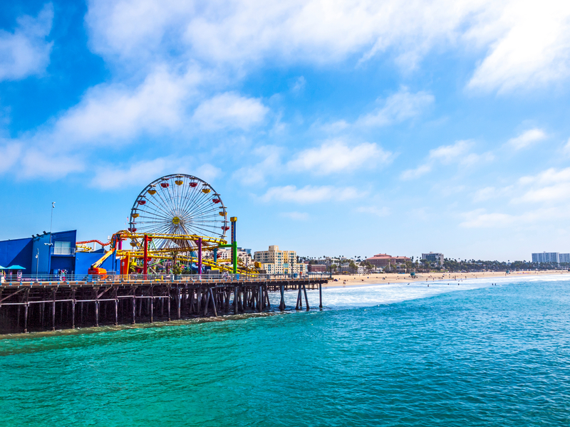 Santa Monica, USA - September 23, 2014: Many people spend their time at Pacific Park on May 4, 2014 in Santa Monica Pier, Los Angeles, CA, USA