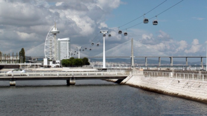 Vasco Da Gama Bridge At Park Of Nations With Cable Car In Lisbon,Portugal,Southwestern Europe