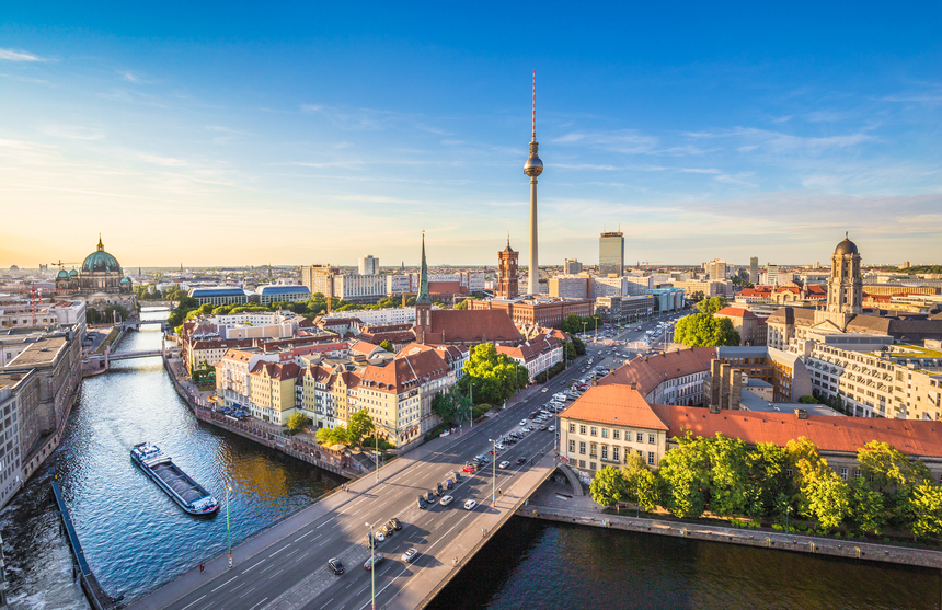 Aerial view of Berlin skyline with famous TV tower and Spree river in beautiful evening light at sunset, Germany.