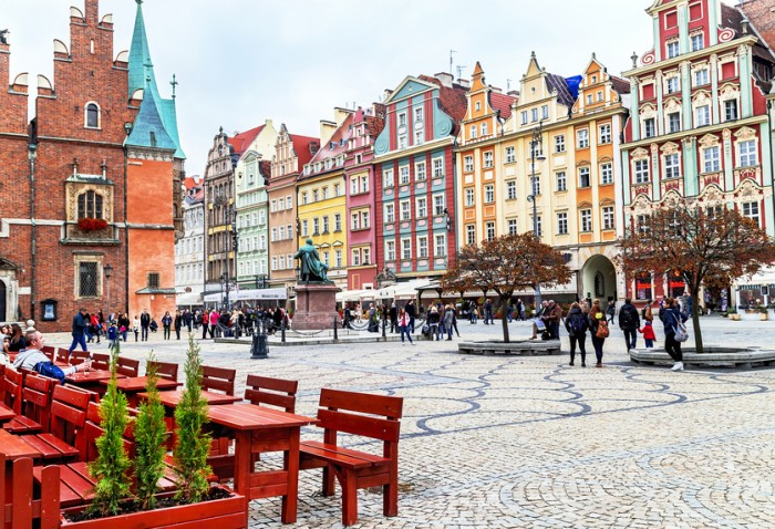 Wroclaw, Poland - October 17, 2015: People walking and resting on the famous, old market square in Wroclaw, Poland. Wroclaw is the historical capital of Silesia. Travel, vacation, arhitectura concept.