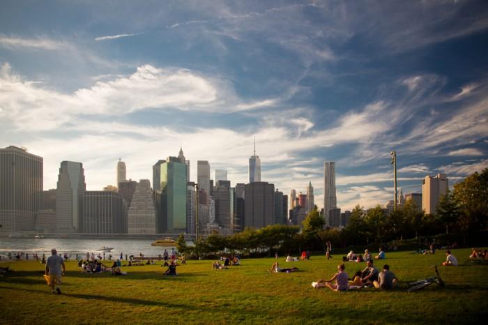 New York City, United States - September 28, 2014: New Yorker enjoying the sunset at Brooklyn Bridge Park