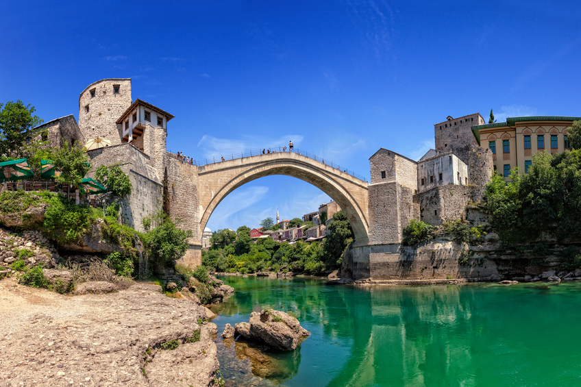 The Old Bridge in Mostar with emerald river Neretva. Bosnia and Herzegovina.