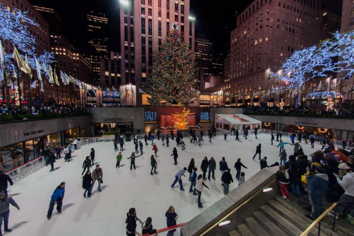 New York, Usa - December 10, 2011: Town People skating at rockfeller center celebrating christmas in manhattan streets