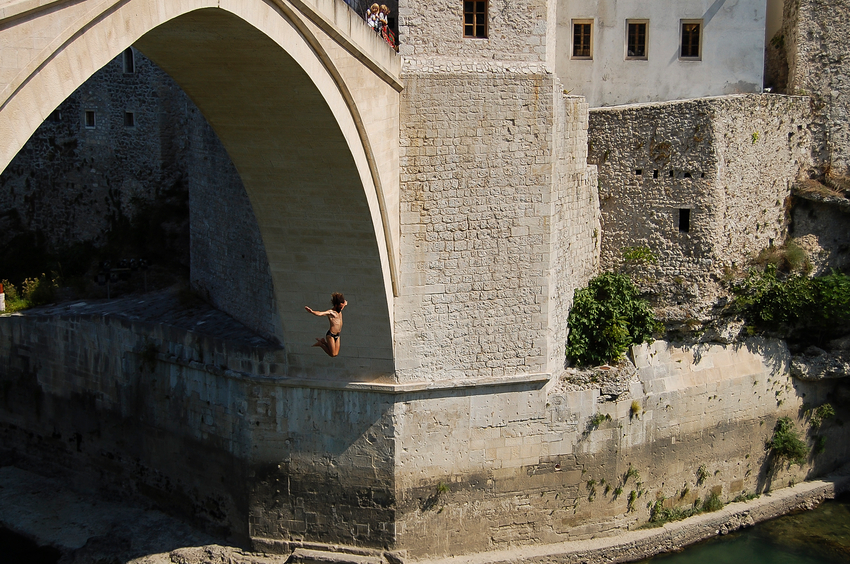 Mostar, Bosnia Herzegovina - September 10, 2009: Bridge jumping activity from Mostar bridge rebuilt after the Balkans war