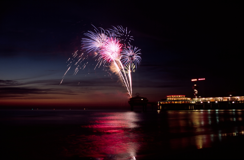 Fireworks at the beach during sunset