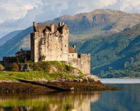 """Dornie, Scotland - July 8, 2011: Eilean Donan Castle and Loch Duich, Dornie, Scotland, United Kingdom."""
