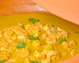 Brazilian prawns in coconut milk and dende oil in a clay pan. Food from Bahia (Cozinha da Daiha)