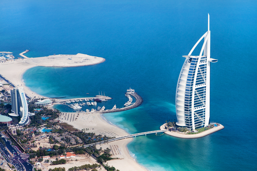Dubai, United Arab Emirates - January 20, 2011: Burj Al Arab, a luxury 5 star hotel built on an artificial island in front of Jumeirah beach from above