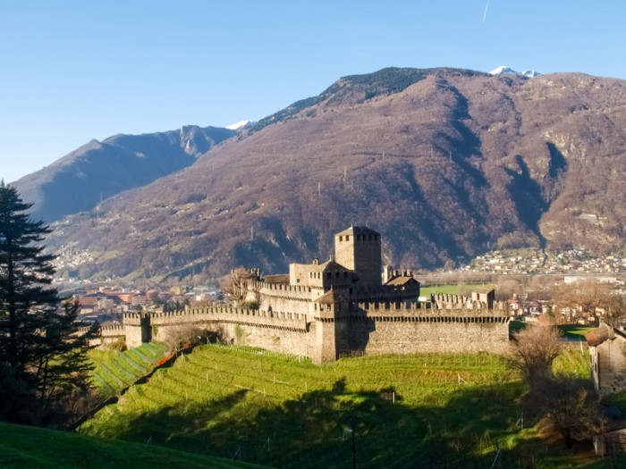 Bellinzona, Switzerland - december 20, 2014: along the pedestrian path of the castles of Castelgrande, Montebello, Sasso Corbaro with afternoon/evening light and blue sky.