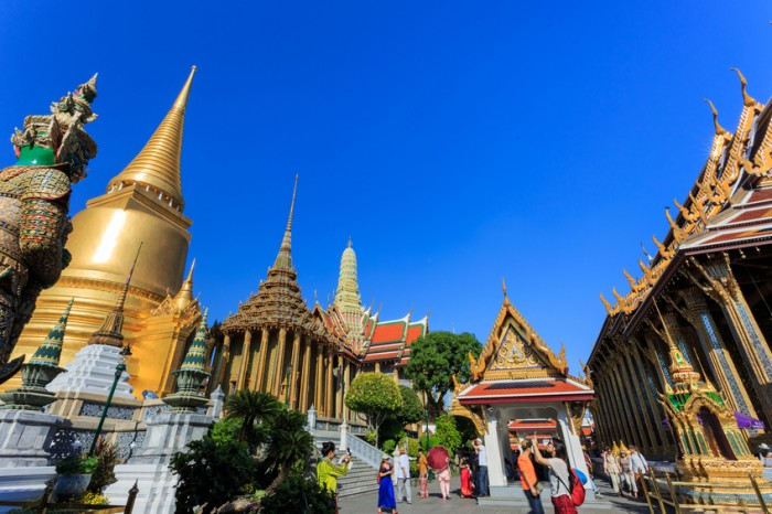 Bangkok, Thailand - February 22, 2015: Wat Phra Kaeo or Grand Palace, landmark of Thailand, many tourists from around the world come to visit and enjoy traditional Thai culture and architecture.