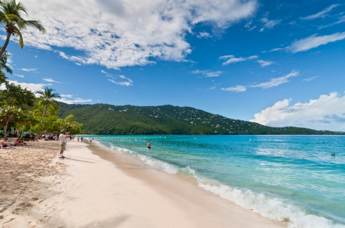 Magens Bay, St. Thomas, U.S. Virgin Islands - December 5, 2011: People enjoy a sunny afternoon at the Magens Bay beach, St. Thomas, U.S.V.I. Magens Bay, voted Top ten beach by National Geography.