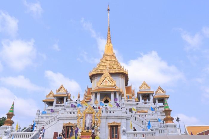 Bangkok Thailand - April 20, 2015: People visit famous Wat Traimit Buddhism temple in Bangkok Thailand.