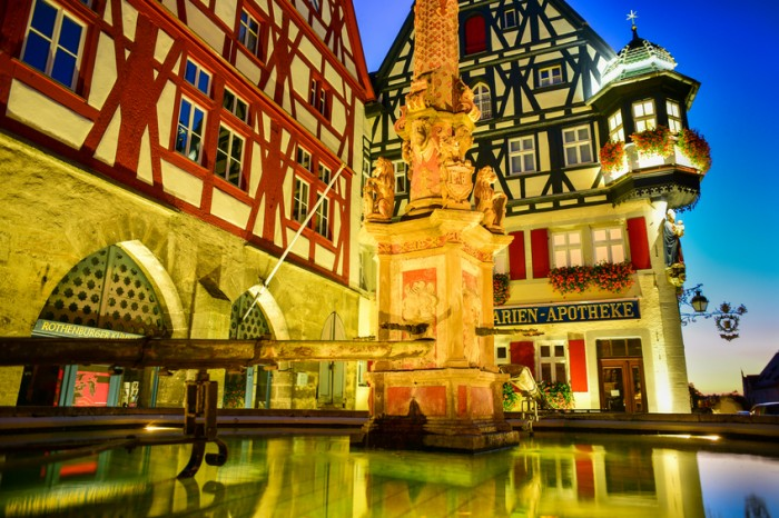 Rothenburg ob der Tauber, Germany - September 30, 2015: An evening view of the market square fountain in this medieval Bavarian city.
