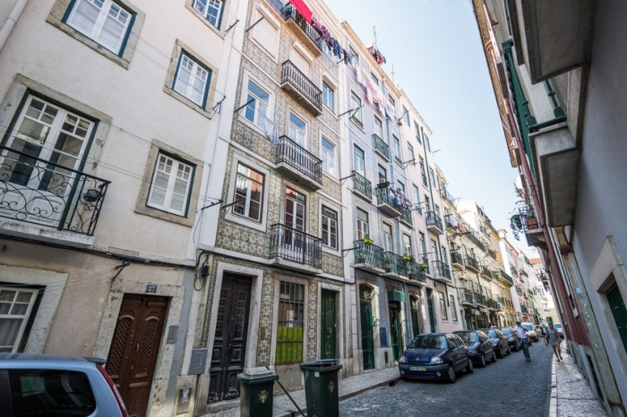 Lisbon, Portugal - September 24, 2015: Narrow street with beautiful old apartment buildings, Bairro Alto (Upper District), Lisbon, Portugal.