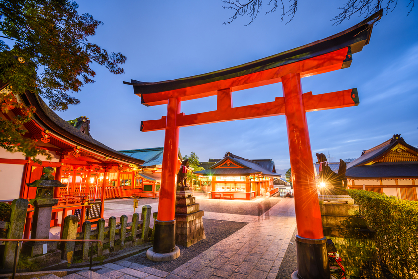 Kyoto, Japan- November 23, 2015: Motion blur of visitors at Fushimi Inari Taisha Shrine. The shrine is noted for its numerous torii gates.
